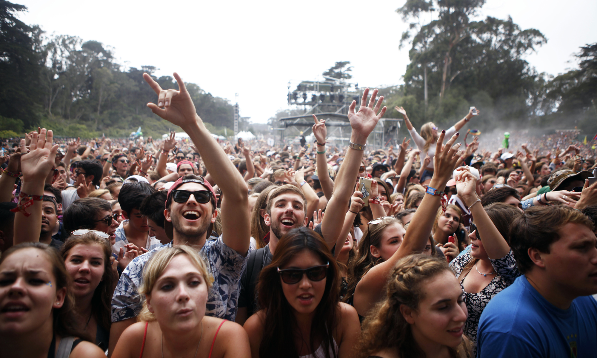 Fans cheer as Odesza performs during Outside Lands on Aug. 9, 2015.